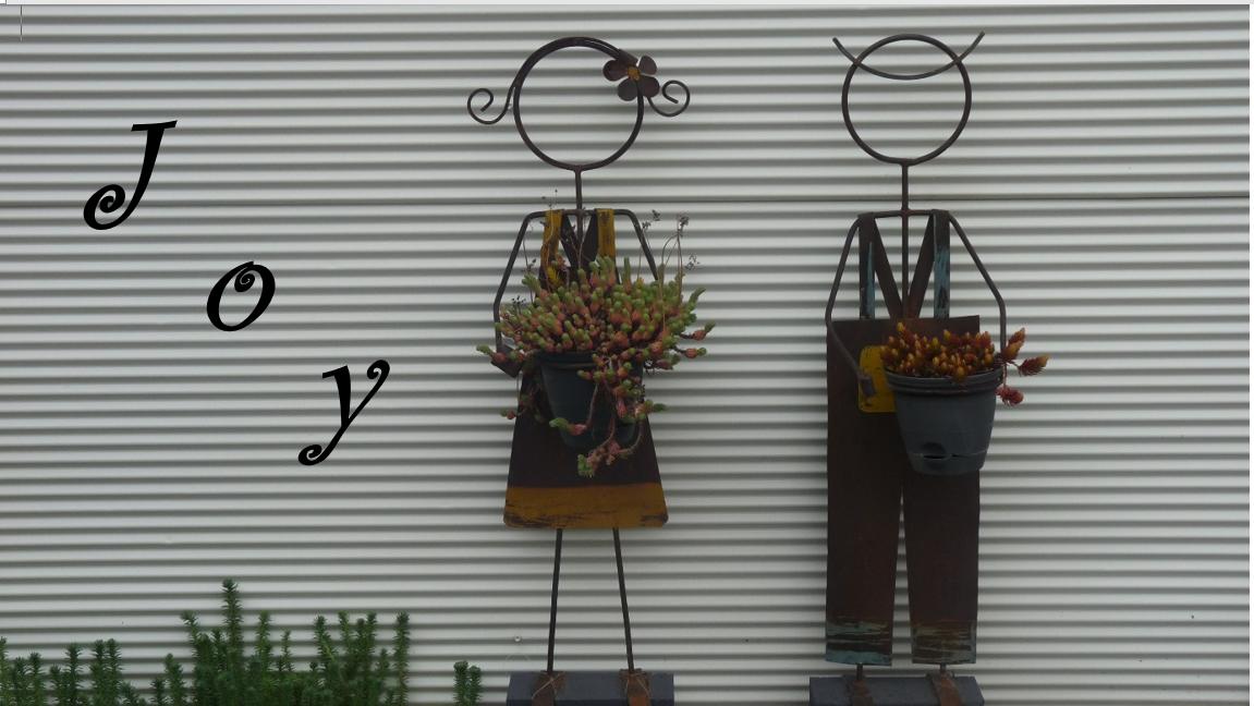 garden figures with word joy